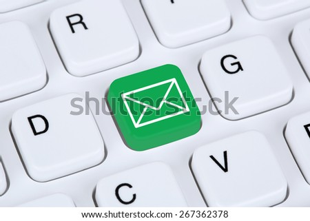 Sending E-Mail via internet on computer keyboard with letter symbol - stock photo