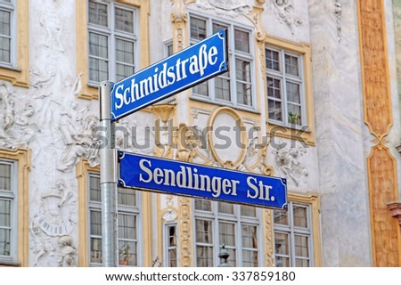 Sendlinger strasse sign in front of the Catholic Church of St. Johann Nepomuk, better known as the Asam Church in Munich, Germany - stock photo
