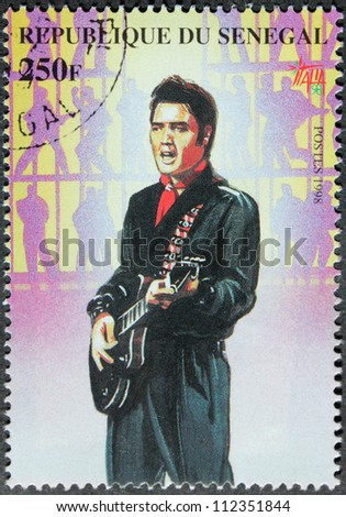 SENEGAL - CIRCA 1998. A postage stamp printed by Senegal shows image portrait of famous American singer Elvis Presley (1935-1977), circa 1998. - stock photo