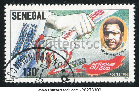SENEGAL - CIRCA 1987: A stamp printed by Senegal, shows Solidarity Against South African Apartheid, circa 1987 - stock photo