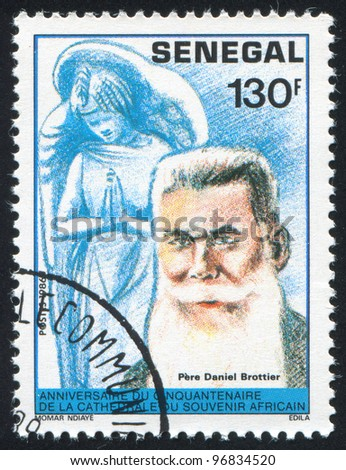 SENEGAL - CIRCA 1987: A stamp printed by Senegal, shows Statue of saint Daniel Brottier, circa 1987