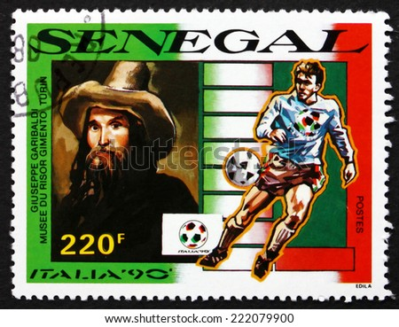 SENEGAL - CIRCA 1990: a stamp printed in Senegal shows Portrait of Giuseppe Garibaldi, Risorgimento Museum, Turin, 1990 World Cup Soccer Championships, Italy, circa 1990 - stock photo