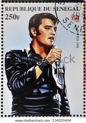 SENEGAL - CIRCA 1998: A stamp printed in Senegal shows the famous Elvis Presley, circa 1998 - stock photo