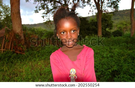 SENEGAL - SEPTEMBER 17: Little unidentified girl from the Bedic ethnicity, the Bedic living on the margins of society on top of a hill, on September 17, 2007 in Country Bassari, Senegal  - stock photo