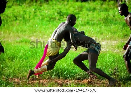 SENEGAL - SEPTEMBER 19: Men fighting in the traditional struggle (wrestle) of Senegal, September 19, 2007 in Casamance, Senegal  - stock photo