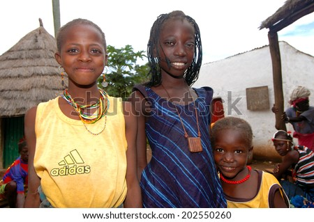 SENEGAL - SEPTEMBER 17: Unidentified girls from the Bedic ethnicity, the Bedic living on the margins of society on top of a hill, on September 17, 2007 in Country Bassari, Senegal  - stock photo