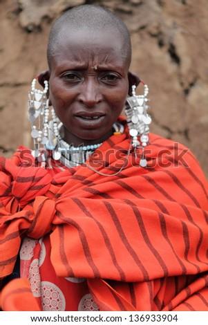 SENETO CULTURAL BOMA, NCA, N TANZANIA/TANZANIA. Portrait of woman, circa February 2013 in Seneto Cultural Boma. Masai are pastoralist people of northern Tanzania and southern Kenya. - stock photo