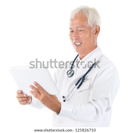 Senior adult Asian specialist medical doctor using tablet computer isolated on white - stock photo