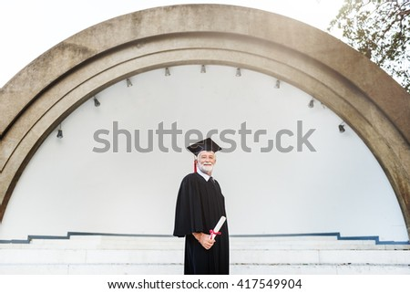 Senior Adult Graduation Success Concept - stock photo