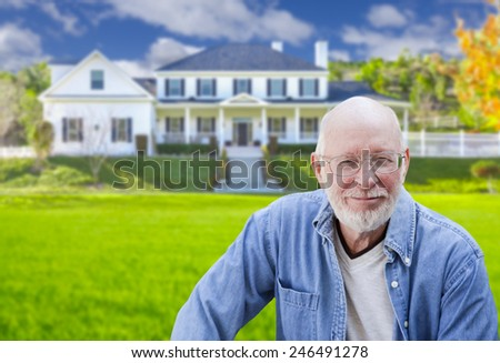 Senior Adult Man in Front of Beautiful House. - stock photo