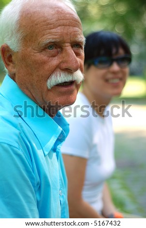 Senior adult with his daughter