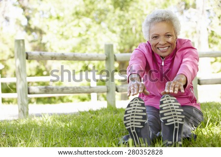 Senior African American Woman Exercising In Park - stock photo
