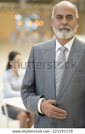 Senior African businessman with hand on jacket - stock photo
