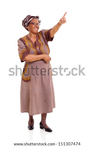 senior african woman pointing isolated on white background - stock photo
