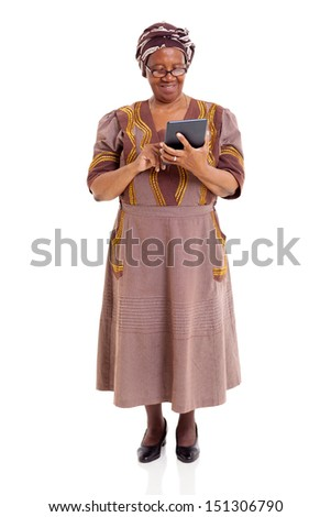 senior african woman using tablet computer isolated on white background