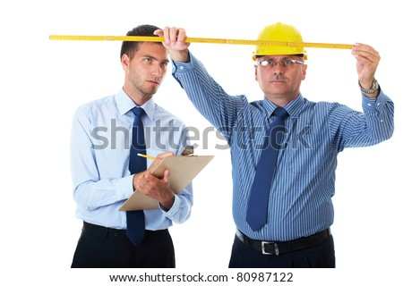 senior and junior businessman discuss and argue over something during their meeting, one of them wear yellow hardhat, isolated on white - stock photo