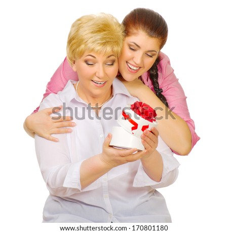 Senior and young woman with gift isolated - stock photo