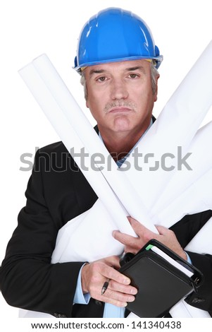 Senior architect holding plans and agenda - stock photo