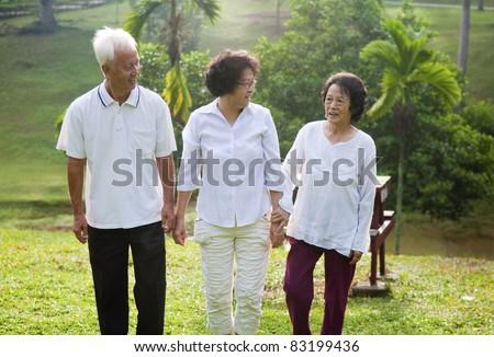 Senior Asian walking outdoor in a morning - stock photo