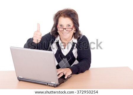 senior beautiful woman with computer isolated in white - stock photo