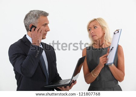 Senior business couple in the middle of a deal - stock photo