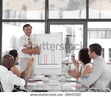 Senior Business man giving a presentation to a group of people