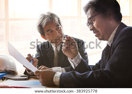senior business man in meeting room - stock photo
