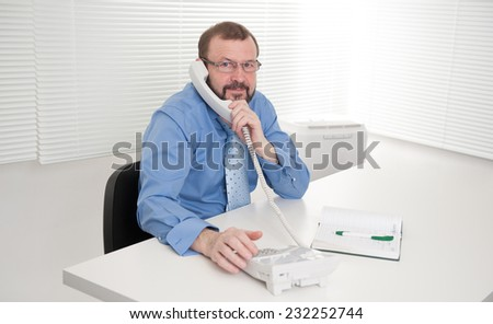 senior business man in the office - stock photo