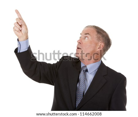 senior business man is pointing at invisible object - stock photo