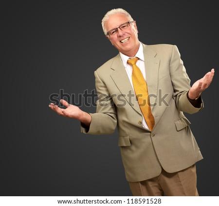 Senior Business Man Presenting Isolated On Black Background - stock photo