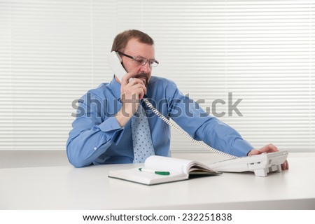 senior business man working in the office - stock photo