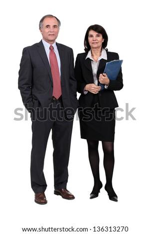 Senior business partners stood together - stock photo
