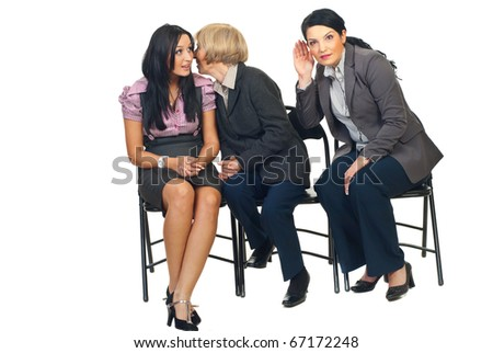 Senior business woman tell a secret  to a colleague woman and other woman trying to hear what her colleagues saying and sitting  all on chairs isolated on white background - stock photo