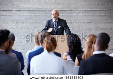 Senior Businessman Addressing Delegates At Conference - stock photo