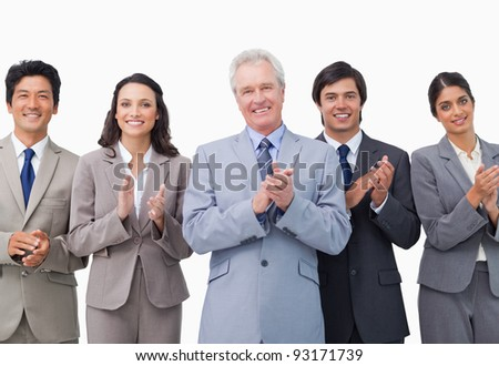 Senior businessman and his team applauding against a white background