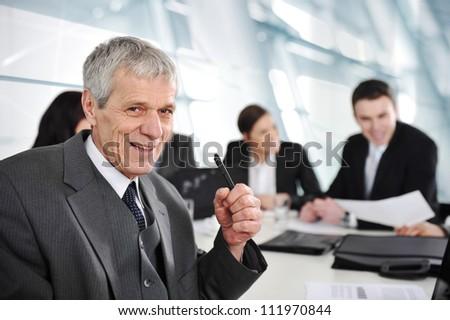Senior businessman at a meeting - stock photo