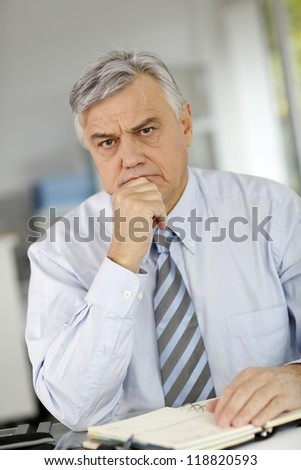Senior businessman being serious in front of client