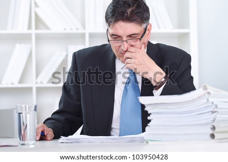Senior businessman concentrate on work in office - stock photo