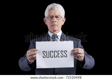 Senior businessman holding a paper with the success word (isolated on black) - stock photo