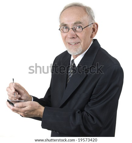 Senior businessman holding electronic diary or calculator
