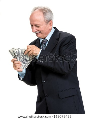 Senior businessman holding group of dollar bills on a white background