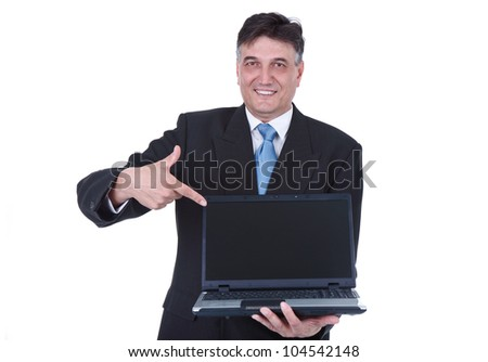 senior businessman holding laptop and pointing in empty screen, isolated on white background - stock photo