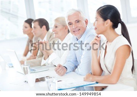 Senior Businessman in a Meeting - stock photo