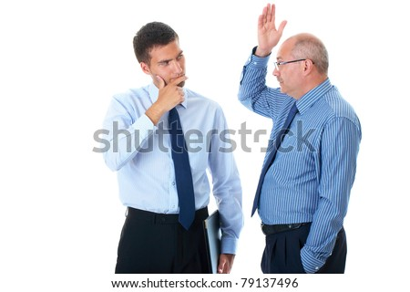 senior businessman, manager explain something to his younger confused colleague, isolated on white