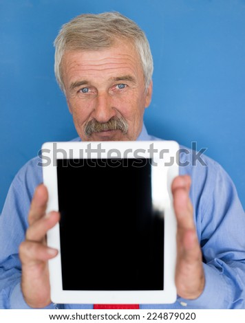 Senior businessman portrait holding tablet for copy space - stock photo