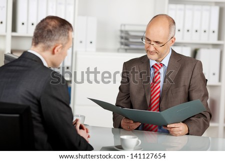 Senior businessman read the application in the office - stock photo
