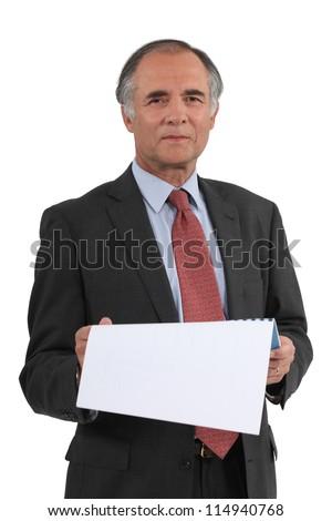Senior businessman reading calendar - stock photo