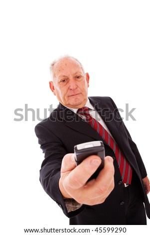 senior businessman sending a text message with his mobile phone - stock photo