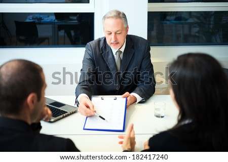 Senior businessman showing a document - stock photo