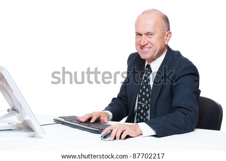 senior businessman sitting in workplace and smiling